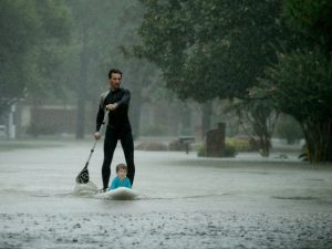 Alexendre Jourge uses evacuates Ethan Colman, 4, from a neighborhood in west Houston inundated by floodwaters from Tropical Storm Harvey on Monday, Aug. 28, 2017, in Houston, Texas. (AP Photo/Charlie Riedel)