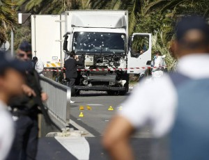 French police secure the area as the investigation continues at the scene near the heavy truck that ran into a crowd at high speed killing scores who were celebrating the Bastille Day July 14 national holiday on the Promenade des Anglais in Nice, France, July 15, 2016.    REUTERS/Eric Gaillard