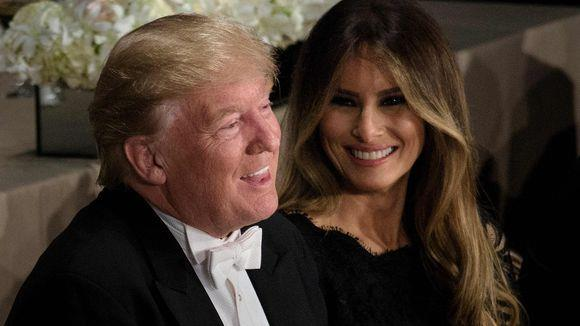 Melania laughing at one of her husband's many jokes