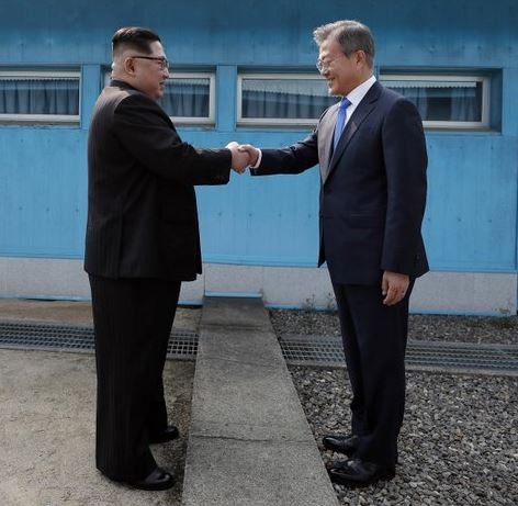 north-south-shake-hands