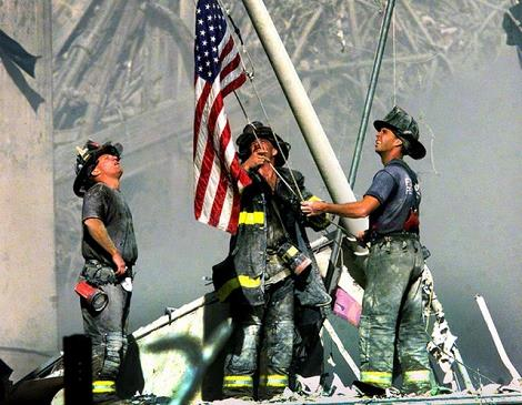 firefighters-hoisting-flag-at-911